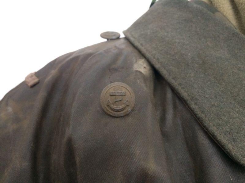 Guzik Kriegsmarine naszyty na płaszczu